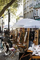 Artist easel in Place Du Tertre, Montmartre, Paris, France