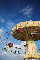 People riding on carousel at Oktoberfest beer festival in Munich, Germany