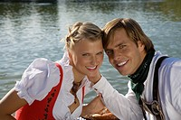 Young couple in traditional Bavarian outfit, portrait, Munich, Germany