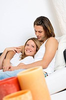 Young couple lying on sofa