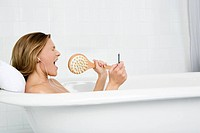 Woman listening to music in the bath