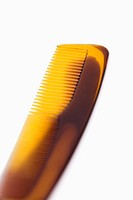 Close up of comb on white background