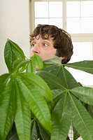 Man carrying house plant