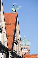 Roof tops of old town with Frauenkirche church tower, Munich, Germany