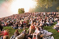 Crowd of spectators at firework display in Olympicpark, Munich, Bavaria, Germany