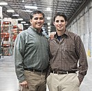 Hispanic father and son in warehouse