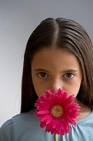 Hispanic girl holding flower