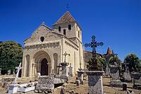 France, Dordogne region, village of Montpeyroux, 12 century Romanesque church, graveyard, chateau in background