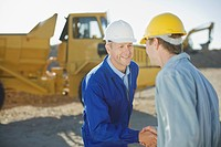 Construction workers shaking hands (thumbnail)