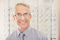 Optometrist standing in optometrist's shop