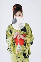 Woman in Kimono Holding Folding Fan