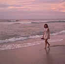 Woman walking down beach