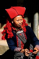 Vietnam, the small mountain village of Sapa, woman of the red Dzao minority group