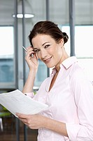 portrait of businesswoman with documents