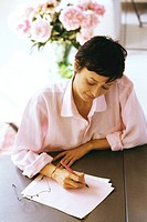 Woman preparing correspondence
