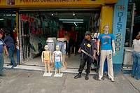 GUATEMALA  Armed guard outside clothes shop in Guatemala City    2009