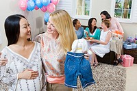 Pregnant Asian Woman with friend at a Baby Shower