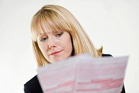 Financial Advisor Studying Paperwork