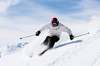Man in white with red helmet off_piste.