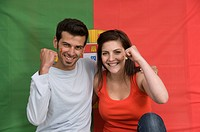 Couple smiling with Portuguese flag