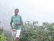 Female Worker With Coffee Beans