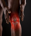 Joints of mixed race man´s knee