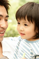 Close up of a young boy with his father