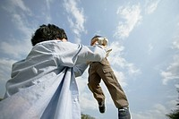 A father lifting his son in air (thumbnail)