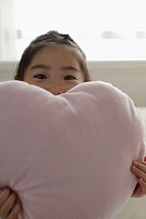 A girl holding a cushion