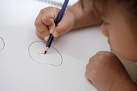 A girl drawing avidly