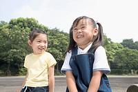 Two girls smiling in park
