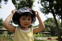 A boy wearing hat