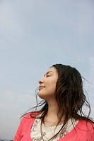 A young woman is seen under the sky with her eyes closed (thumbnail)