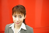 A businesswoman smiling at the camera (thumbnail)
