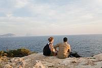 Hikers overlooking the sea