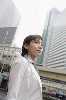 A low angle view of a woman with commercial buildings at the background (thumbnail)