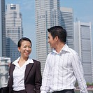 Portrait of a businesswoman smiling with a businessman