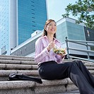 Low angle view of a businesswoman holding a bowl of salad