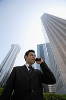 Businessman conversing on a cellphone