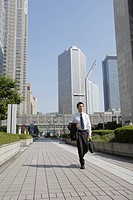 Businessman walking on a sidewalk