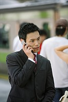 Businessman conversing on his cellphone, portrait (thumbnail)