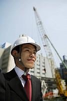 Businessman with a hard hat, portrait