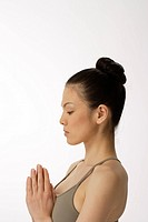 Side view of a young woman meditating