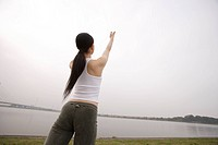 View of a young woman exercising outdoors