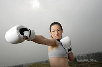 View of a young woman boxing