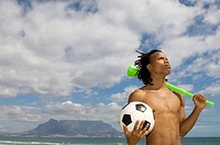 Young boy holding vuvuzela and soccer ball, Table Mountain in background, Table View, Cape Town, Western Cape Province, South Africa