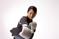 Portrait of a young woman boxing
