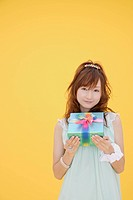 Portrait of a teenage girl with a gift box (thumbnail)