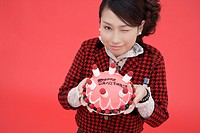 View of teenage girl holding a birthday cake