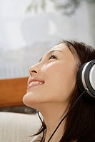 Close_up of a young woman using a headphone